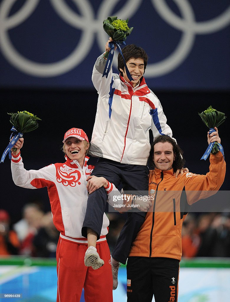 <a gi-track='captionPersonalityLinkClicked' href=/galleries/search?phrase=Ivan+Skobrev&family=editorial&specificpeople=725692 ng-click='$event.stopPropagation()'>Ivan Skobrev</a> of Russia celebrates winning silver, <a gi-track='captionPersonalityLinkClicked' href=/galleries/search?phrase=Lee+Seung-Hoon&family=editorial&specificpeople=2537373 ng-click='$event.stopPropagation()'>Lee Seung-Hoon</a> of South Korea gold and Bob De Jong of Netherlands bronze during the flower ceremony for the men's 10000 m speed skating on day 12 of the 2010 Vancouver Winter Olympics at Richmond Olympic Oval on February 23, 2010 in Vancouver, Canada.