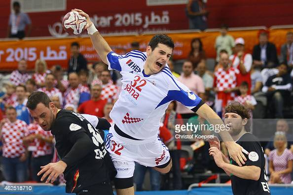 Ivan Sliskovic of Croatia scores a goal against Jens Schoengarth of Germany and Johannes Sellin of Germany during the placement round between Croatia...
