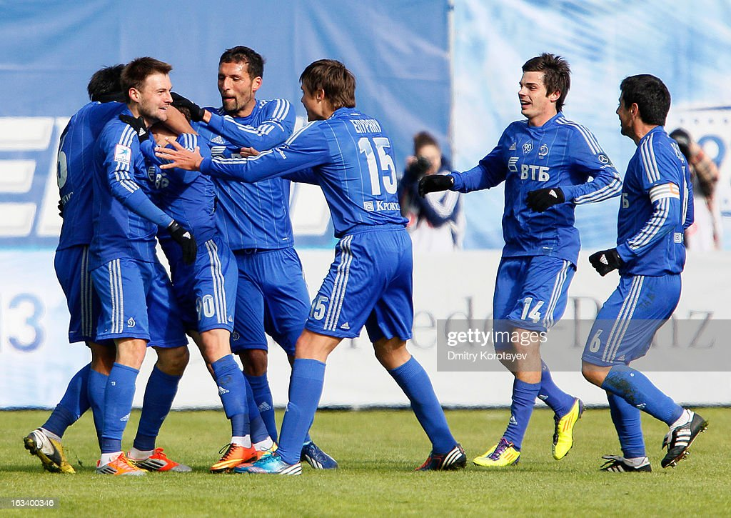 Ivan Solovyev of FC Dynamo Moscow is congratulated by <a gi-track='captionPersonalityLinkClicked' href=/galleries/search?phrase=Kevin+Kuranyi&family=editorial&specificpeople=202968 ng-click='$event.stopPropagation()'>Kevin Kuranyi</a> (4th L), Alexandru Epureanu and team-mates after scoring the opening goal of the Russian Premier League match between FC Dynamo Moscow and FC Lokomotiv Moscow at the Arena Khimki Stadium on March 09, 2013 in Khimki, Russia.