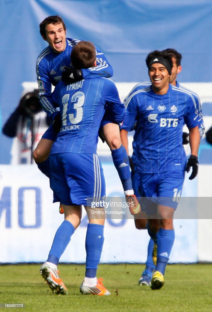 Ivan Solovyov (top) celebrates with team-mates Vladimir Granat and Christian Noboa of FC Dynamo Moscow after scoring the opening goal of the Russian Premier League match between FC Dynamo Moscow and FC Lokomotiv Moscow at the Arena Khimki Stadium on March 09, 2013 in Khimki, Russia.