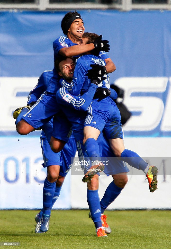 Ivan Solovyov (R) celebrates with team-mates Vladimir Granat and Christian Noboa (to) of FC Dynamo Moscow after scoring the opening goal of the Russian Premier League match between FC Dynamo Moscow and FC Lokomotiv Moscow at the Arena Khimki Stadium on March 09, 2013 in Khimki, Russia.