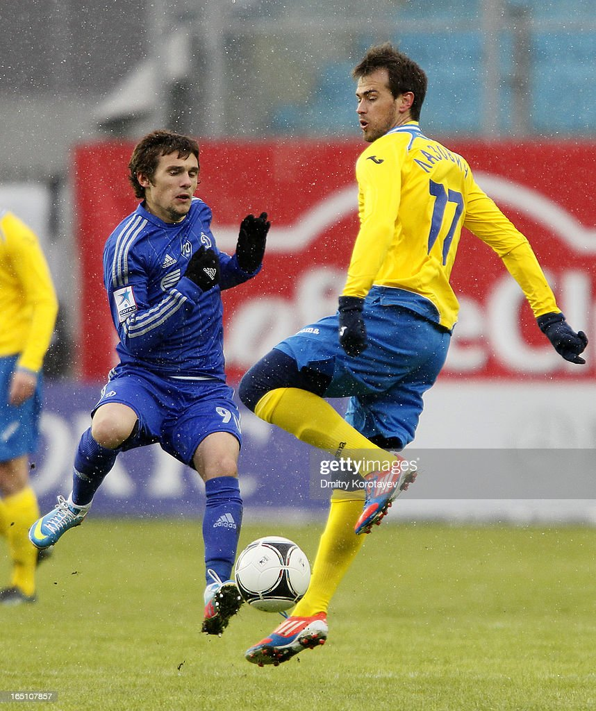 Ivan Solovyov of FC Dynamo Moscow is challenged by <a gi-track='captionPersonalityLinkClicked' href=/galleries/search?phrase=Danko+Lazovic&family=editorial&specificpeople=2219062 ng-click='$event.stopPropagation()'>Danko Lazovic</a> (R) of FC Rostov Rostov-on-Don during the Russian Premier League match between FC Dynamo Moscow and FC Rostov Rostov-on-Don at the Arena Khimki Stadium on March 30, 2013 in Khimki, Russia.