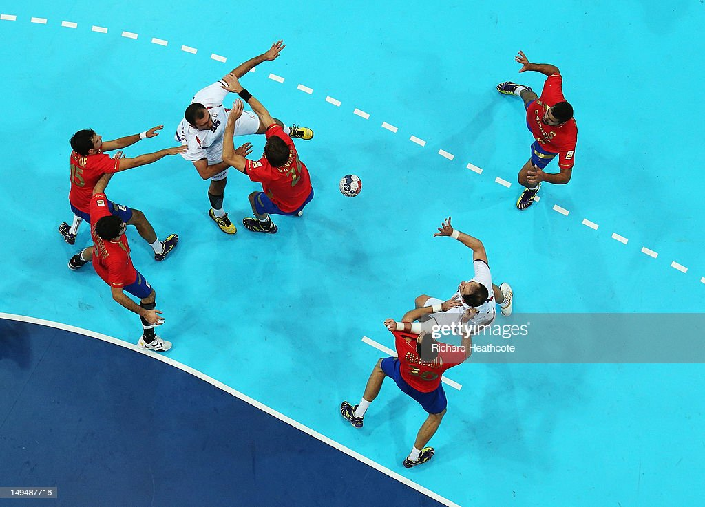 Ivan Stankovic (L) of Serbia passes the ball to Alem Toskic of Serbia during the Men's Handball preliminaries group B match between Spain and Serbia on Day 2 of the London 2012 Olympic Games at the Copper Box on July 29, 2012 in London, England.