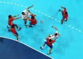 Ivan Stankovic of Serbia passes the ball to Alem Toskic of Serbia during the Men's Handball preliminaries group B match between Spain and Serbia on...