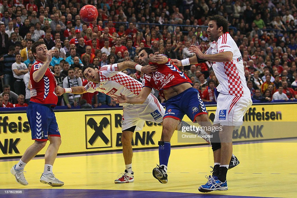 Ivan Stankovic of Serbia (3rd L) scores a goal against <a gi-track='captionPersonalityLinkClicked' href=/galleries/search?phrase=Blazenko+Lackovic&family=editorial&specificpeople=663011 ng-click='$event.stopPropagation()'>Blazenko Lackovic</a> of Croatia (2nd L) and <a gi-track='captionPersonalityLinkClicked' href=/galleries/search?phrase=Igor+Vori&family=editorial&specificpeople=784502 ng-click='$event.stopPropagation()'>Igor Vori</a> of Croatia (R) during the Men's European Handball Championship second semi final match between Serbia and Croatia at Beogradska Arena on January 27, 2012 in Belgrade, Serbia.