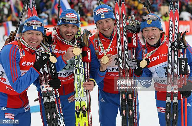 Ivan Tcherezov Nikolay Kruglov Dmitir Yaroshenko and Maxim Tchoudov of Russia show their gold medals after winning the Mens 4 x 75 km relay of the...