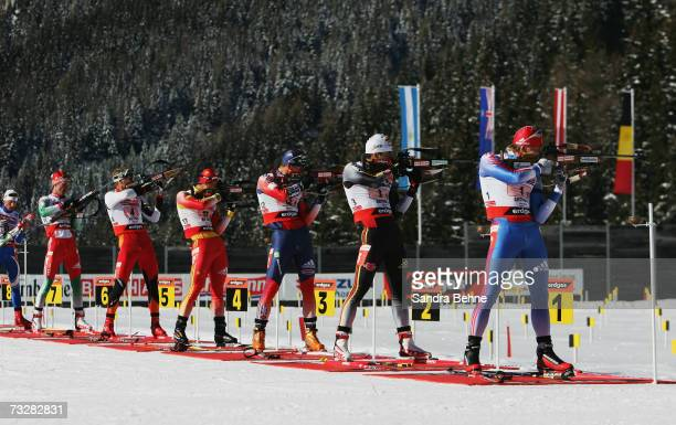 Ivan Tcherezov of Russia Ricco Gross of Germany Jay Hakkinen of the USA Chengye Zhang of China shoot during the Men's 4 x 75 Relay in the Biathlon...