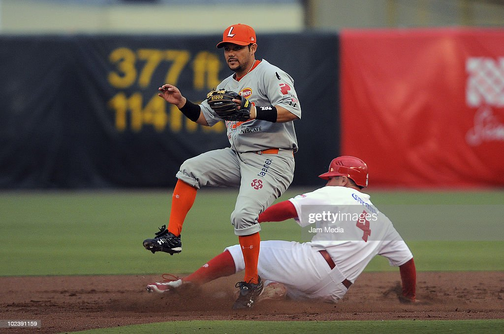 Ivan Terrazas (R) of Diablos Rojos in action against Julian Laurean of Vaqueros Laguna during a match between Diablos Rojos and Vaqueros Laguna as part of the 2010 Mexican Baseball League at the Foro Sol Stadium on June 24, 2010 in Mexico City, Mexico.