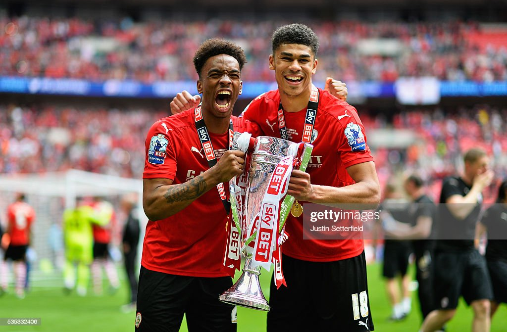 Ivan Toney of Barnsley FC and Ashley Fletcher of Barnsley FC celebrate after wiining the Sky Bet League One Play Off Final between against Millwall at Wembley Stadium on May 29, 2016 in London, England.