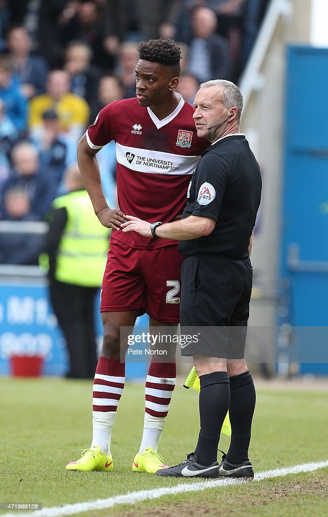 Ivan Toney of Northampton Town and assistant referee Paul Thompson look on during the Sky Bet League Two match between Northampton Town and Wycombe Wanderers at Sixfields Stadium on May 2, 2015 in Northampton, England.