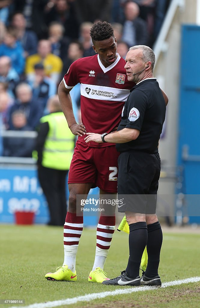 Ivan Toney of Northampton Town looks to assistant referee Paul Thompson during the Sky Bet League Two match between Northampton Town and Wycombe Wanderers at Sixfields Stadium on May 2, 2015 in Northampton, England.