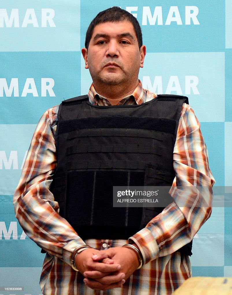 Ivan Velazquez Caballero, aka 'Z 50' or 'El Taliban', senior leader in the Zetas drug cartel and member of the Gulf cartel, is presented to the press at the Mexican Navy headquarters in Mexico City, on September 27, 2012. Velazquez Caballero was on a list of Mexico's most wanted drug traffickers, with an offer of some $2.3 million for information leading to his capture. AFP PHOTO/Alfredo Estrella