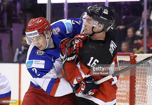 TORONTO ON DECEMBER 19 Ivan Vereshagin and Max Domi battle as Team Canada out shoots Team Russia 5320 but loses 21 in overtime in a 2015 IIHF World...