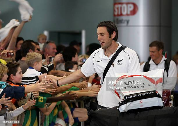 Ivan Vicelich and Ben Sigmund of the New Zealand All Whites greet the fans as they arrive home from the 2010 World Cup at the Auckland International...