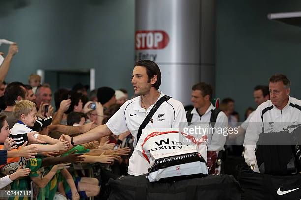 Ivan Vicelich Ben Sigmund and assistant coach Brian Turner of the New Zealand All Whites greet the fans as they arrive home from the 2010 World Cup...