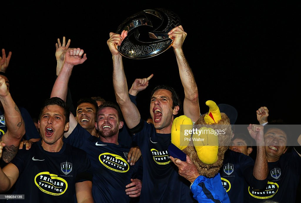 Ivan Vicelich of Auckland holds up the OFC Champions League trophy following the OFC Champions League Final match between Auckland and Waitakere at Mt Smart Stadium on May 19, 2013 in Auckland, New Zealand.