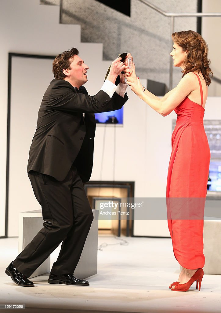Ivan Vrgoc and Julia Bremermann perform during the 'Geruechte...Geruechte...' photo rehearsal at Komoedie am Kurfuerstendamm Theater on January 9, 2013 in Berlin, Germany.