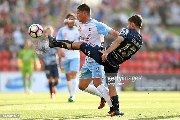 Ivan Vujica of the Jets and Filip Holosko of Sydney FC contest the ball during the round four ALeague match between the Newcastle jets and Sydney FC...
