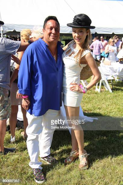 Ivan Wilzig and Mina Otsuka attend the First Annual Polo Hamptons Match at Southampton Polo Club on June 24 2017 in New York City