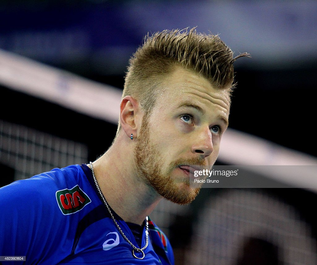 <a gi-track='captionPersonalityLinkClicked' href=/galleries/search?phrase=Ivan+Zaytsev+-+Volleyball+Player&family=editorial&specificpeople=7880025 ng-click='$event.stopPropagation()'>Ivan Zaytsev</a> of Italy shows his dejection during the FIVB World League Final Six semifinal match between Italy and Brazil at Mandela Forum on July 19, 2014 in Florence, Italy.