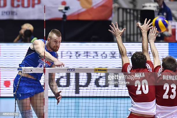 Ivan Zaytsev of Italy spikes in the match between Italy and Poland during the FIVB Men's Volleyball World Cup Japan 2015 at Yoyogi National Gymnasium...