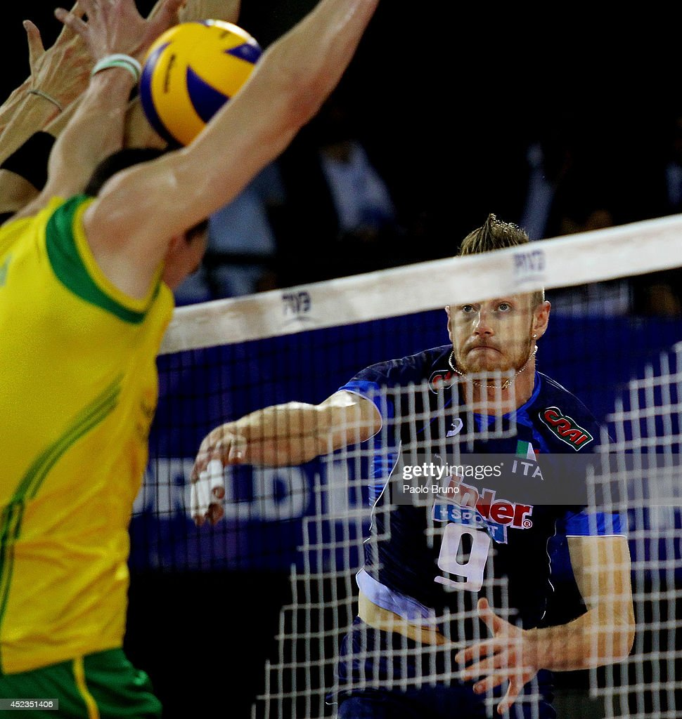 <a gi-track='captionPersonalityLinkClicked' href=/galleries/search?phrase=Ivan+Zaytsev+-+Volleyball+Player&family=editorial&specificpeople=7880025 ng-click='$event.stopPropagation()'>Ivan Zaytsev</a> of Italy spikes the ball during the FIVB World League Final Six match between Australia and Italy at Mandela Forum on July 18, 2014 in Florence, Italy.