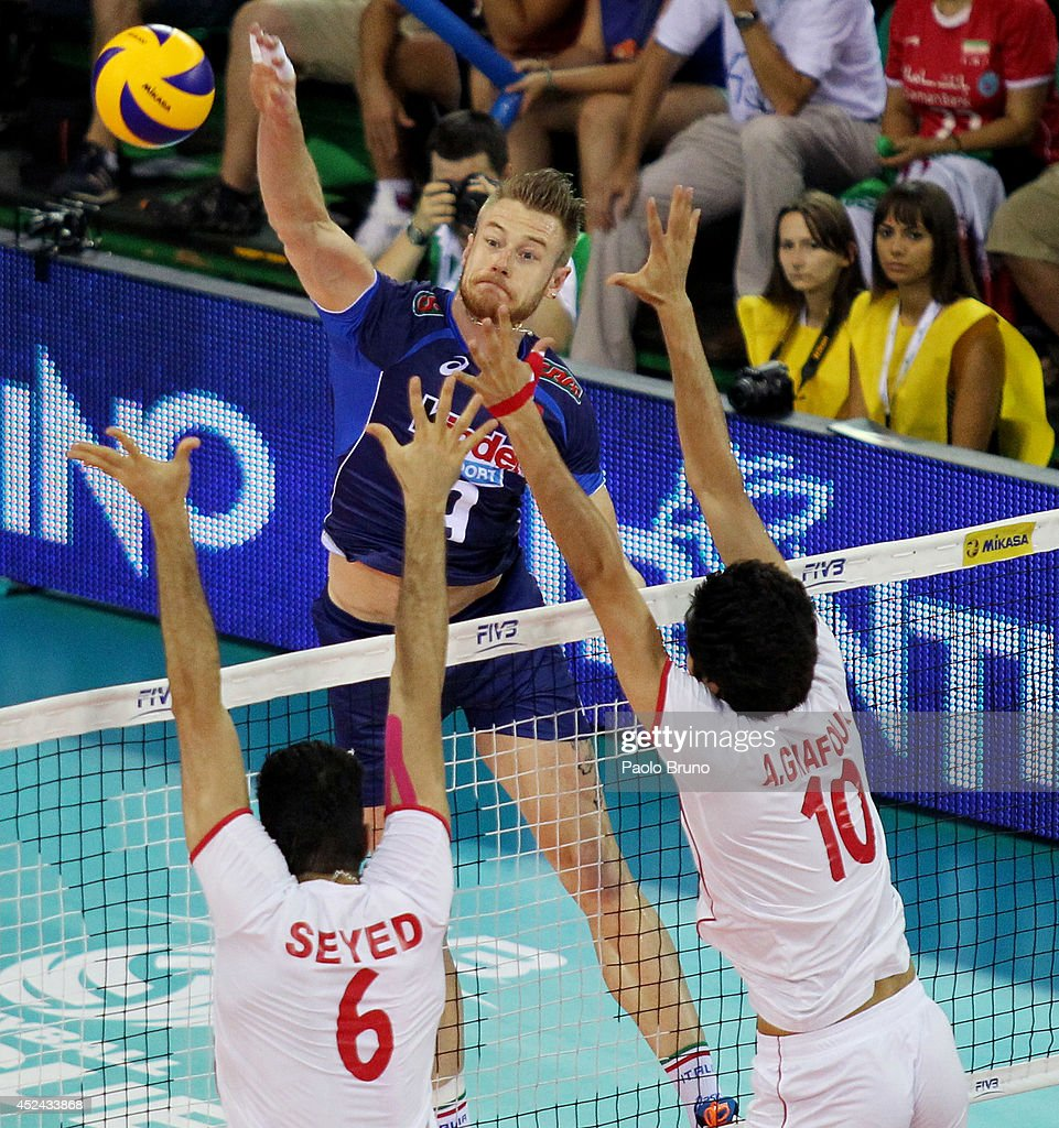 Ivan Zaytsev of Italy spikes the ball during the FIVB World League Final Six match for the third place between Iran and Italy at Mandela Forum on July 20, 2014 in Florence, Italy.