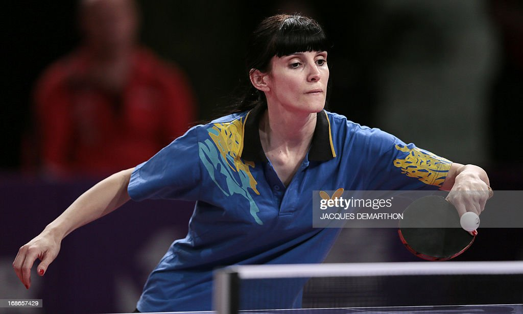 Ivana Dalovic of Montenegro returns the ball to Rahel Aschwanden of Switzerland on May 13, 2013 in Paris, during their World Table Tennis Championships women's singles qualifications groups match. DEMARTHON