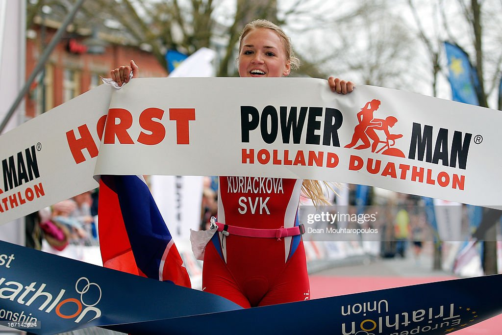 Ivana Kuriackova of Slovakia celebrates as she crosses the finish line to win the Junior Womens Long Distance race during the 2013 Horst ETU Powerman Long Distance and Sprint Duathlon European Championships on April 21, 2013 in Horst, Netherlands.