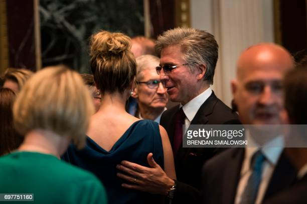 Ivanka Trump and Bill McDermott CEO of SAP talk during an event with technology sector CEOs at the White House on June 19 2017 in Washington DC / AFP...