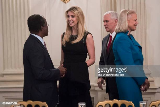 Ivanka Trump and Vice President Pence greet others before a strategy and policy forum in the State Dining Room of the White House in Washington DC on...