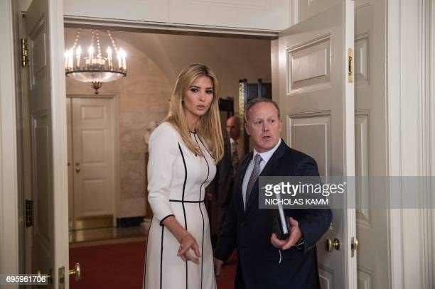 Ivanka Trump and White House spokesman Sean Spicer are seen after US President Donald Trump delivers a statement in the Diplomatic Room at the White...