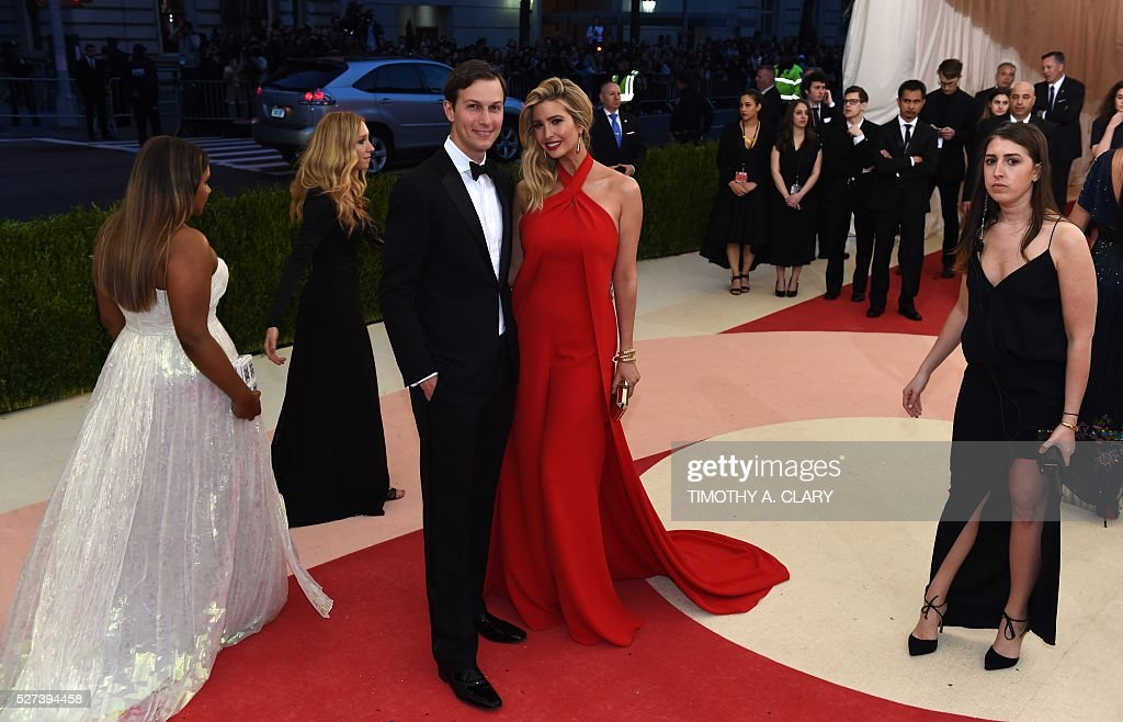 Ivanka Trump (red dress) arrives for the Costume Institute Benefit at The Metropolitan Museum of Art May 2, 2016 in New York. / AFP / TIMOTHY
