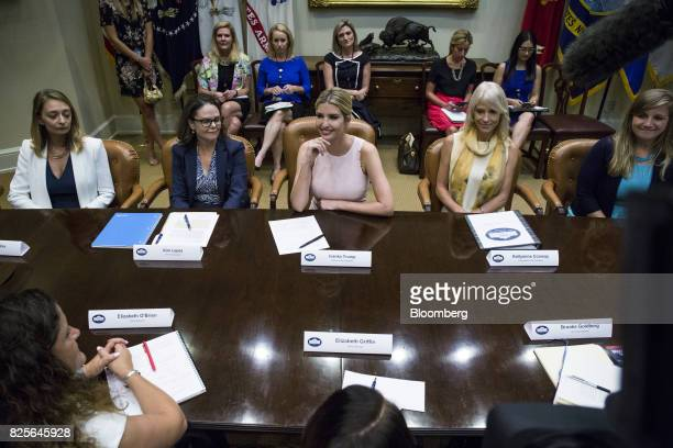 Ivanka Trump assistant to US President Donald Trump center and Kellyanne Conway senior advisor to US President Donald Trump second right smile during...