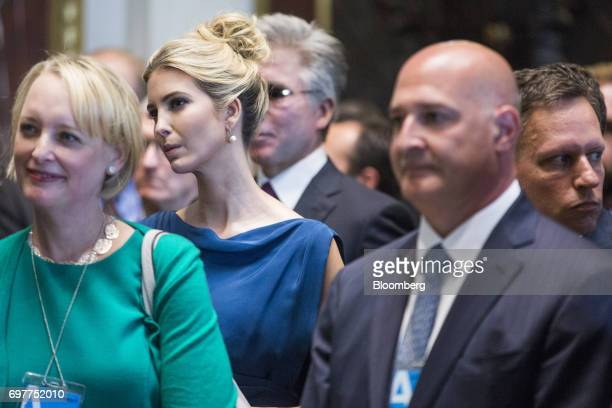 Ivanka Trump assistant to US President Donald Trump listens as her husband Jared Kushner senior White House adviser not pictured speaks during a...