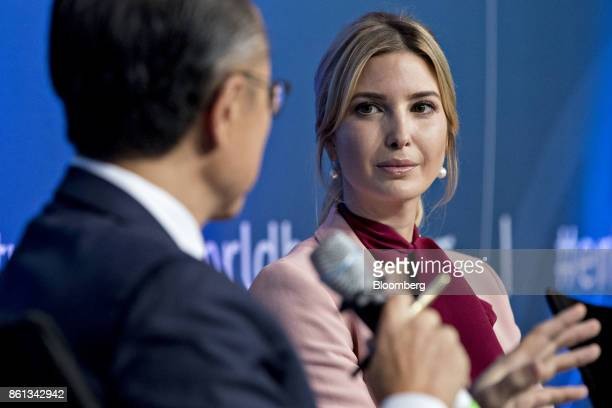 Ivanka Trump assistant to US President Donald Trump listens as Jim Yong Kim president of the World Bank Group left speaks during a panel discussion...