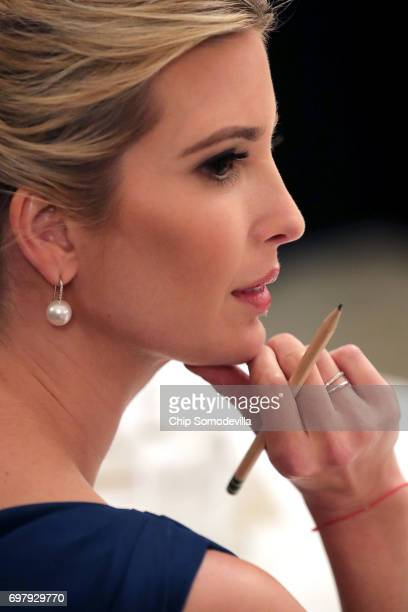Ivanka Trump attends a meeting of the American Technology Council with her father US President Donald Trump in the State Dining Room of the White...