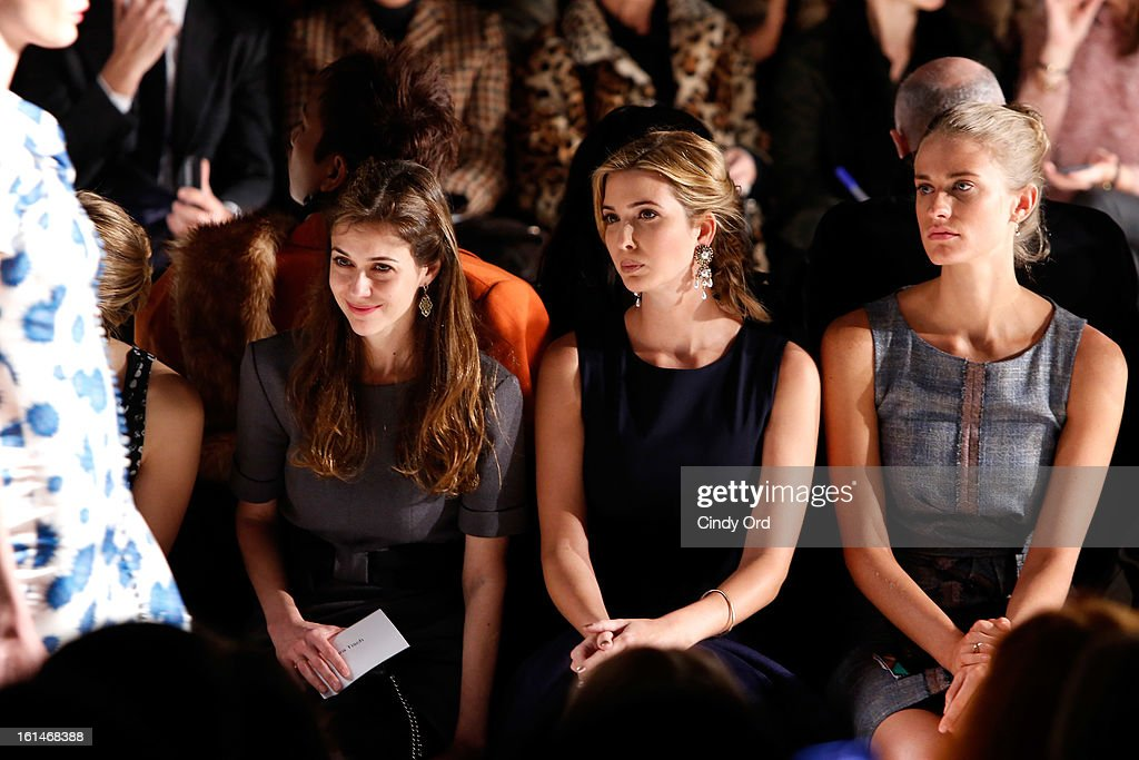 <a gi-track='captionPersonalityLinkClicked' href=/galleries/search?phrase=Ivanka+Trump&family=editorial&specificpeople=159375 ng-click='$event.stopPropagation()'>Ivanka Trump</a> (center) attends the Carolina Herrera Fall 2013 fashion show during Mercedes-Benz Fashion Week at The Theatre at Lincoln Center on February 11, 2013 in New York City.