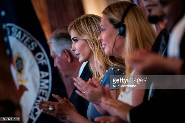 Ivanka Trump claps during an event about the 2017 Human Trafficking Report at the US State Department June 27 2017 in Washington DC US President...