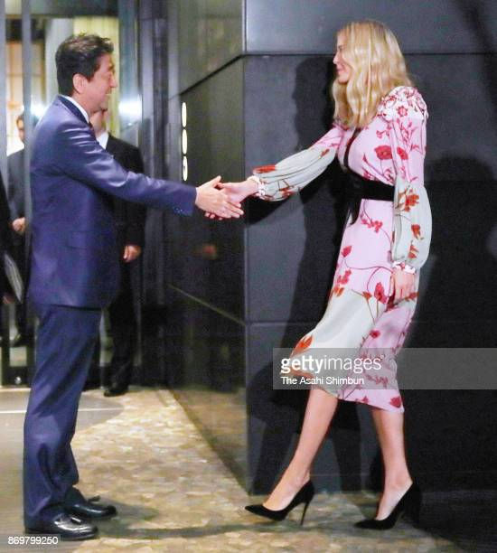 Ivanka Trump daughter and advisor of the US president Donald Trump shakes hands with Japanese Prime Minister Shinzo Abe prior to their dinner on...