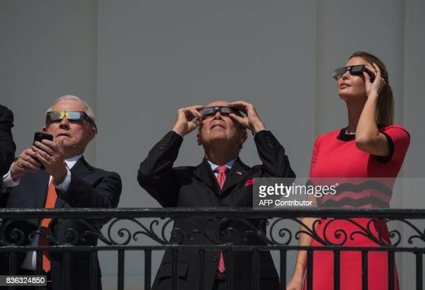 Ivanka Trump daughter and advisor of US President Donald Trump Commerce Secretary Wilbur Ross and Attorney General Jeff Sessions look up at the...