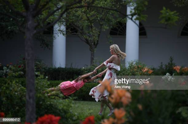 Ivanka Trump daughter and assistant to President Donald Trump plays with her daughter Arabella Rose Kushner in the Rose Garden during during a...