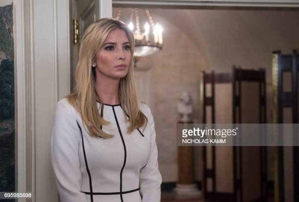 Ivanka Trump daughter and of US President Donald Trump looks on before her father delivered a statement in the Diplomatic Room at the White House in...