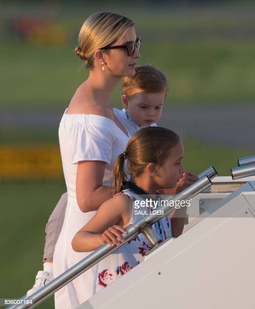 Ivanka Trump daughter of US President Donald Trump along with her children Arabella and Theodore board Air Force One prior to departure Morristown...