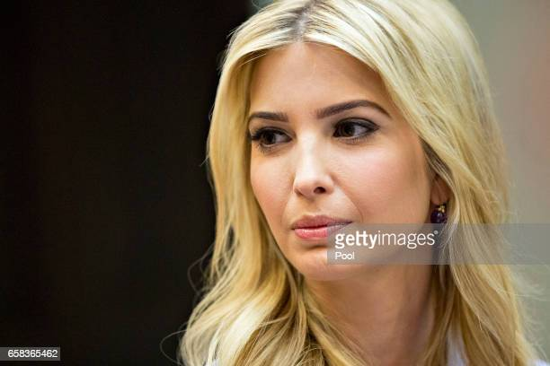 Ivanka Trump daughter of US President Donald Trump listens while meeting with women small business owners with Trump not pictured in the Roosevelt...