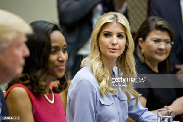 Ivanka Trump daughter of US President Donald Trump listens while meeting with Trump left and women small business owners in the Roosevelt Room of the...