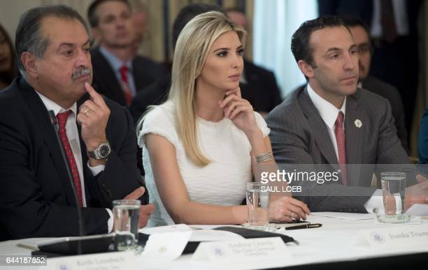 Ivanka Trump daughter of US President Donald Trump sits alongside Dow Chemical President Chairman and CEO Andrew Liveris and White House Assistant...