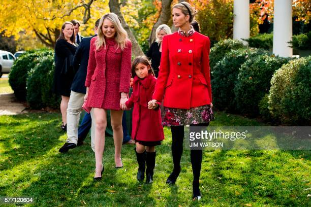 Ivanka Trump holds her daughter Arabella Kushner's hand as she walk with sister Tiffany Trump after viewing the pardoned Thanksgiving turkey...