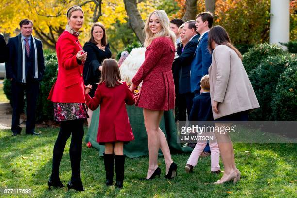 Ivanka Trump holds her daughter Arabella Kushner's hand as Tiffany Trump and White House Press Secretary Sarah Sanders walk up to see the pardoned...