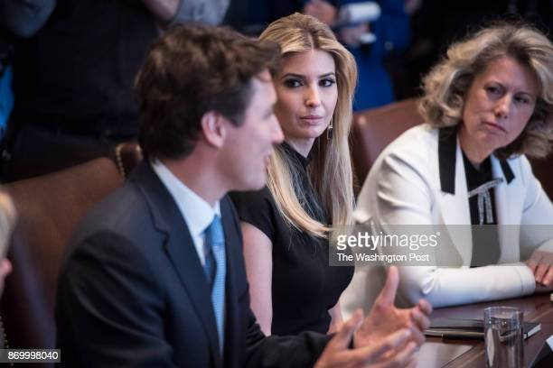 Ivanka Trump listens as Canadian Prime Minister Justin Trudeau speaks as he and President Donald Trump host a meeting with women business leaders in...